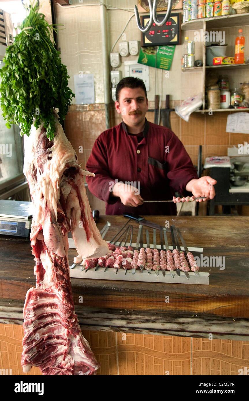 Hama Syria Bazaar market butcher grill restaurant - Stock Image