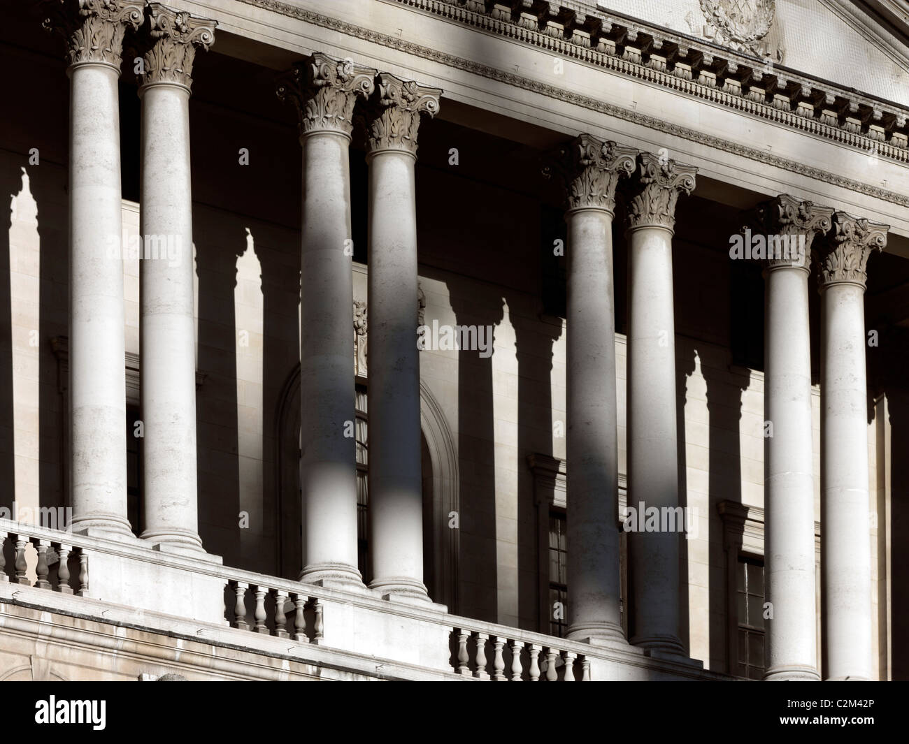 Bank of England, Threadneedle Street, City of London. Detail of pediment and columns - Stock Image