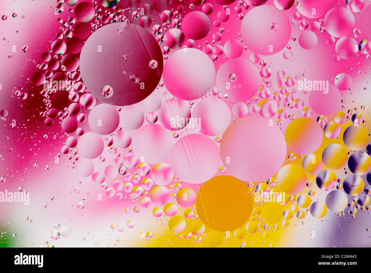 Macro closeup of cooking oil bubbles in water-Victoria, British Columbia, Canada. - Stock Image