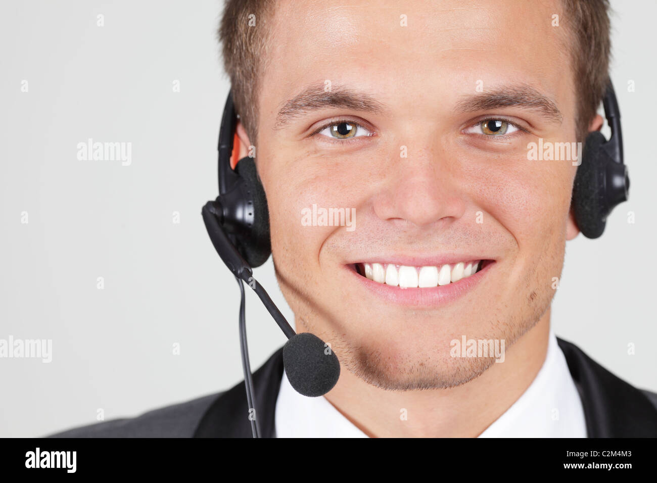 Customer support operator woman smiling isolated - Stock Image