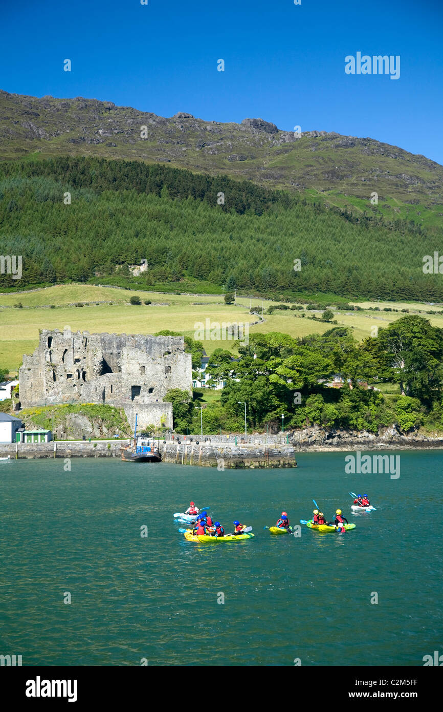 Sea kayaking group in Carlingford Lough, beneath Slieve Foy. County Louth, Ireland. - Stock Image