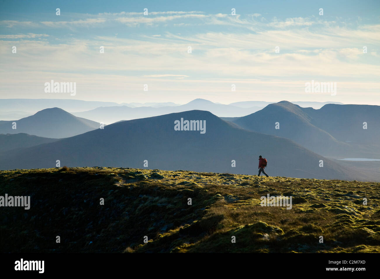 Walker on the summit ridge of Slieve Carr, Nephin Beg Mountains, Ballycroy National Park, County Mayo, Ireland. - Stock Image