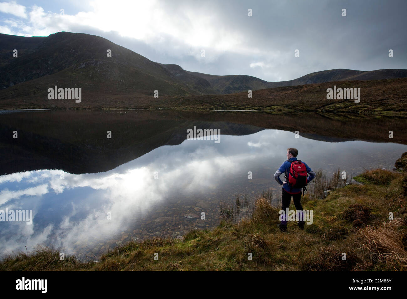 Walker beside Lough Laur, Corraun Hill, County Mayo, Ireland. - Stock Image