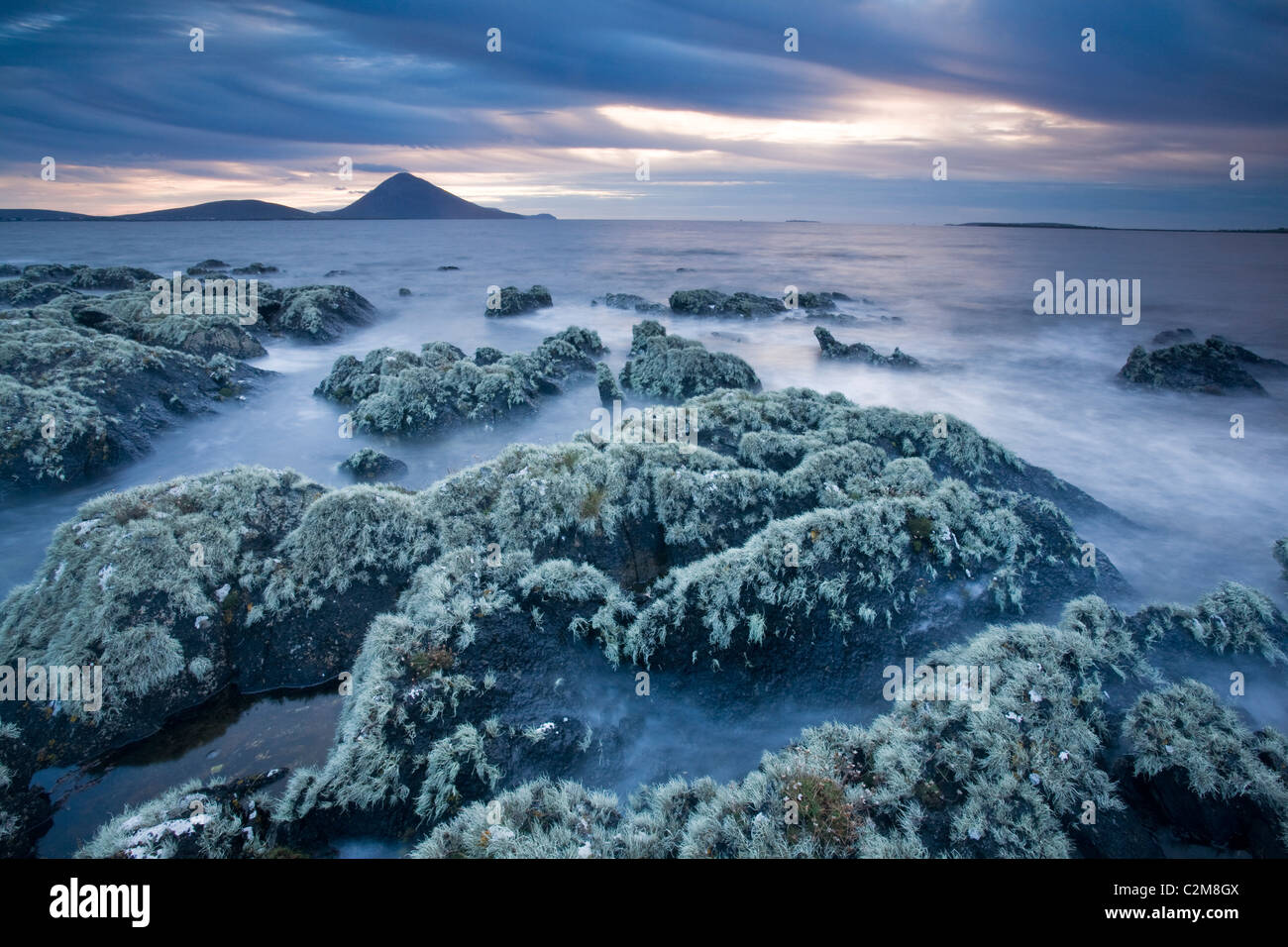 Lichen-covered rocks along the Atlantic shoreline, Ballycroy, County Mayo, Ireland. - Stock Image