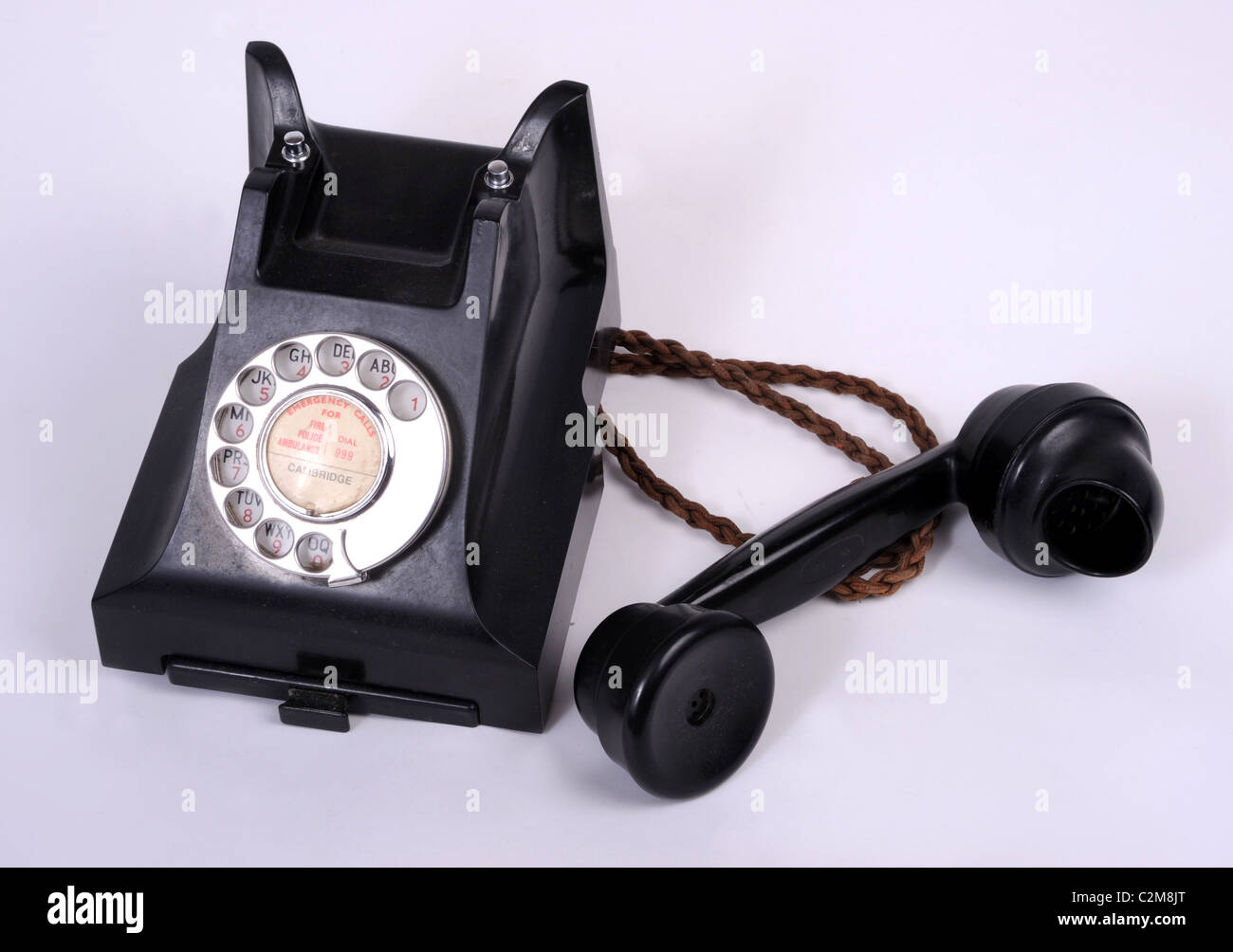 An old dial type 1950s bakelite telephone. - Stock Image