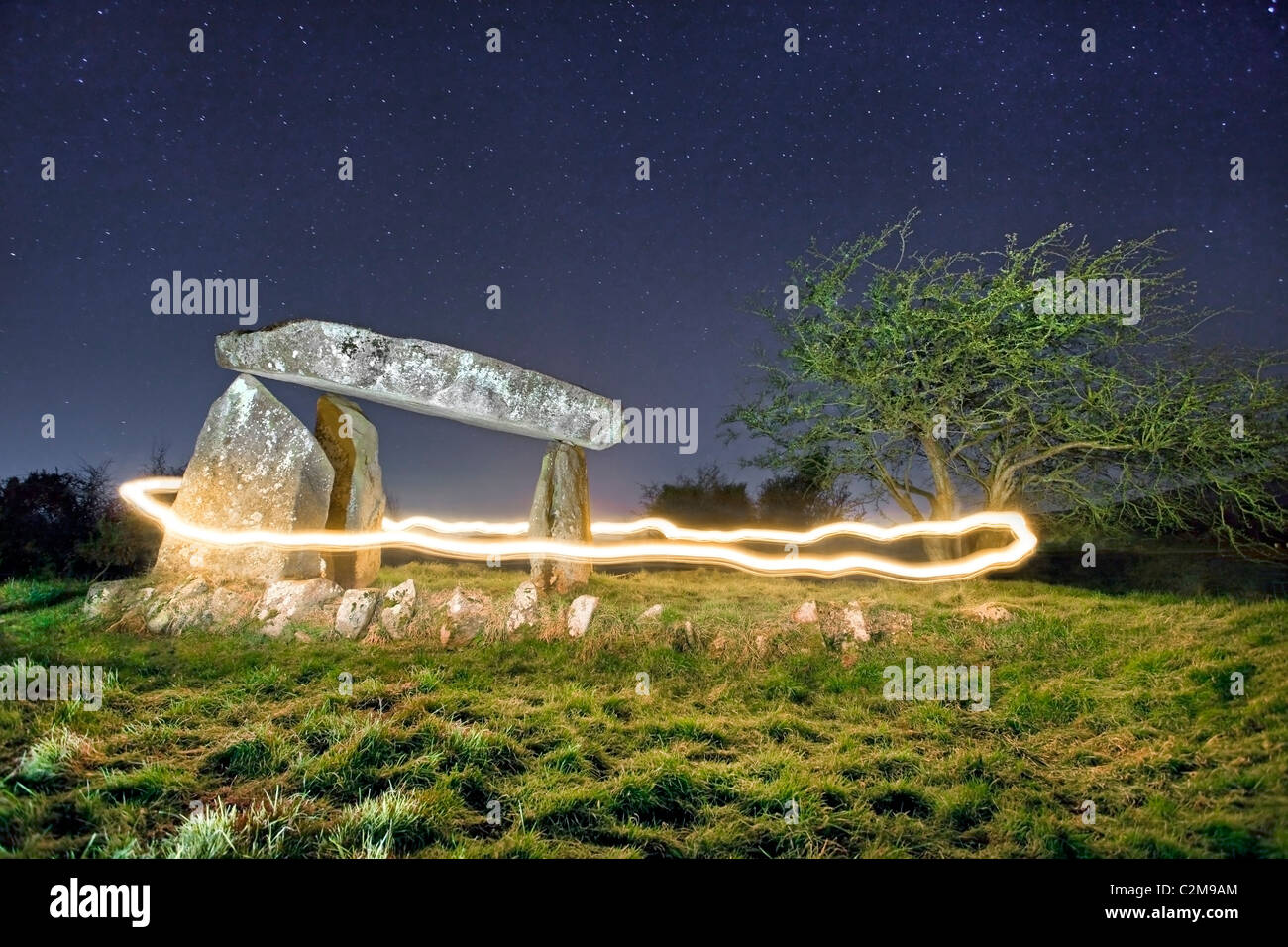 Ring of fire around Ballykeel Dolmen in Co. Armagh , Northern Ireland. - Stock Image