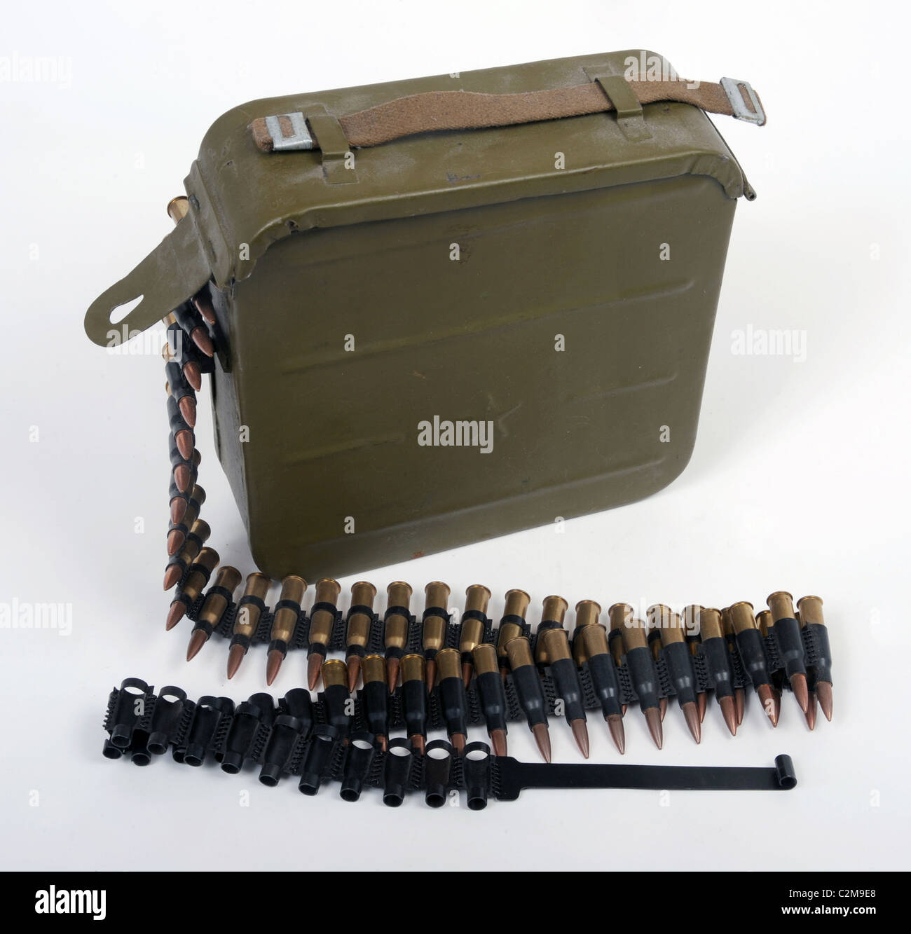 A soviet Russian 7.62mm belt fed ammunition container with a belt of machine gun bullets. - Stock Image