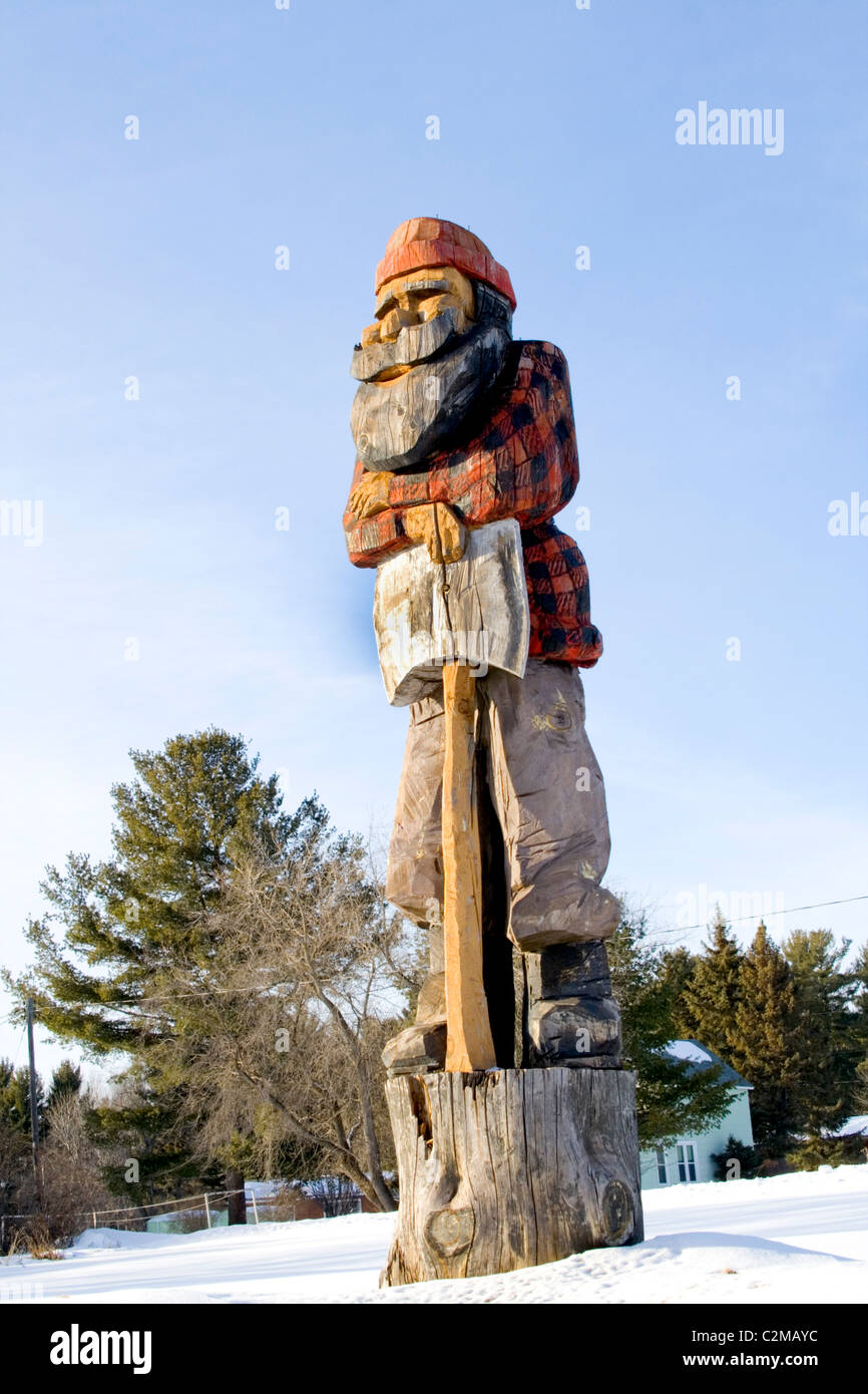 Wooden sculpture of lumberjack paul bunyan holding a double bladed