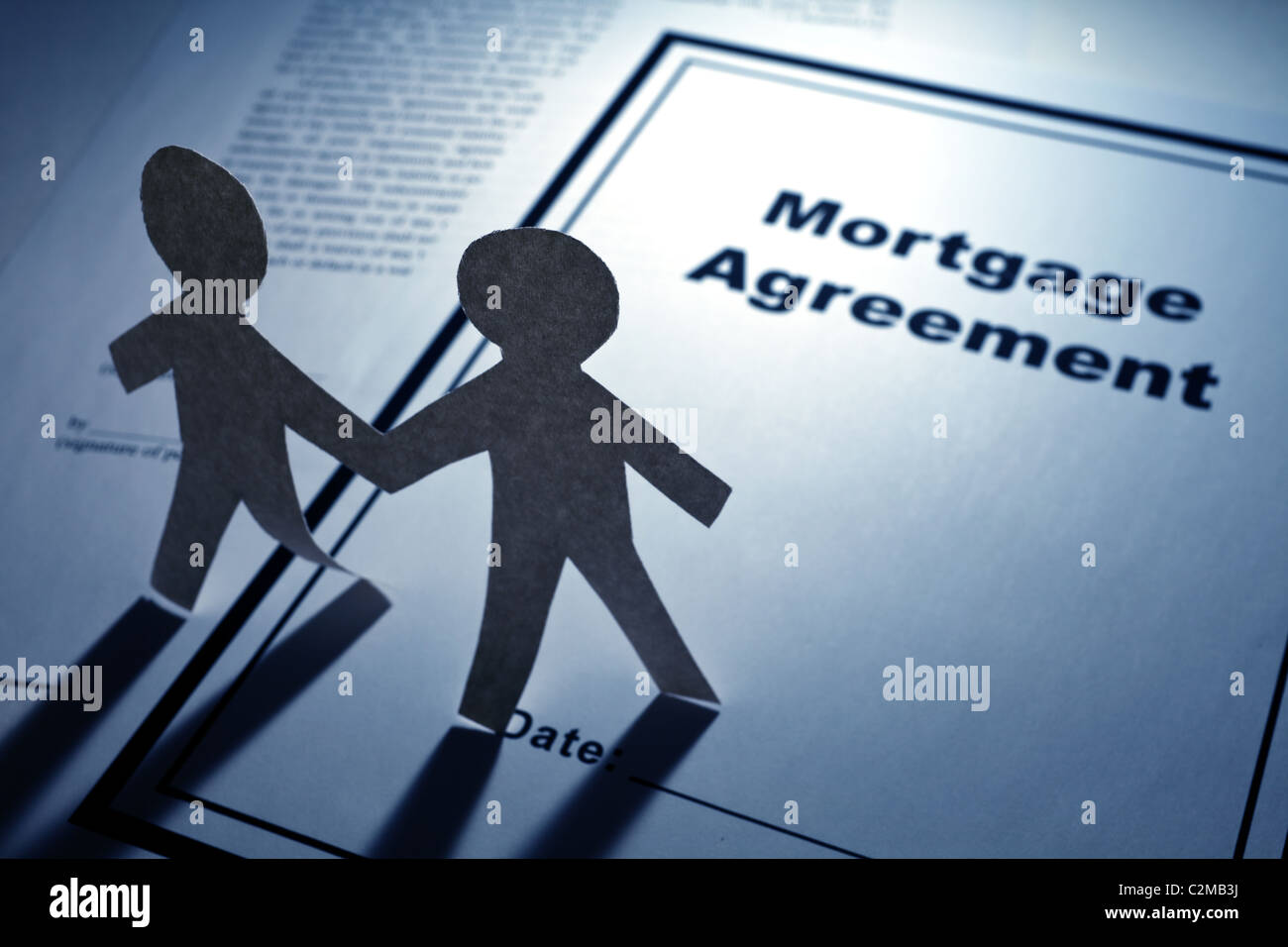 Mortgage Agreement and Paper Chain Men close up - Stock Image