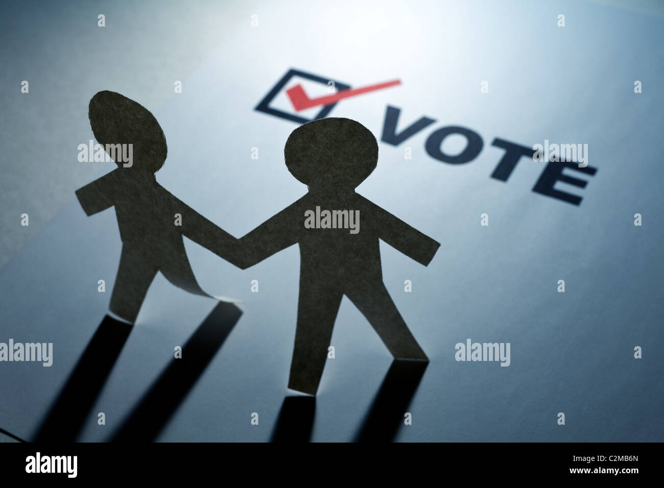 vote and Paper Chain Men close up - Stock Image