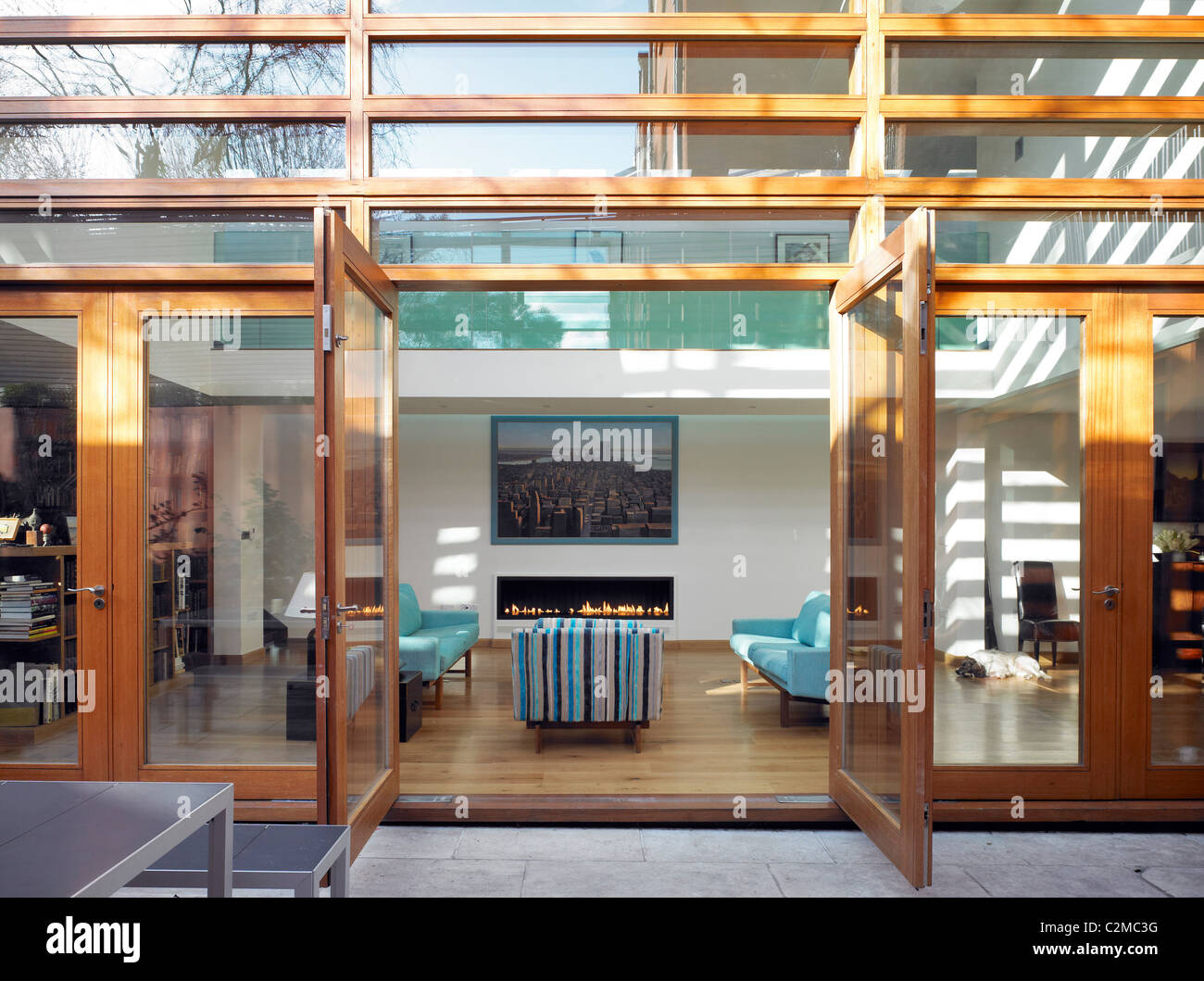 Garden House. Outdoor eating area with wooden patio doors - Stock Image