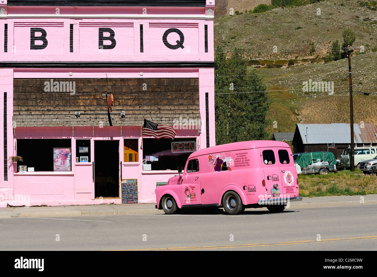Pink car outside a pink BBQ restaurant on Blair Street, Silverton city, Silverton in the mountains of Colorado, Stock Photo