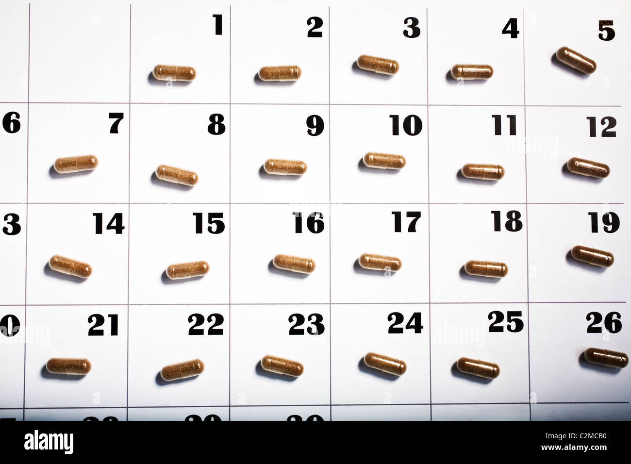Pills On Each Day Of The Calendar Stock Photo
