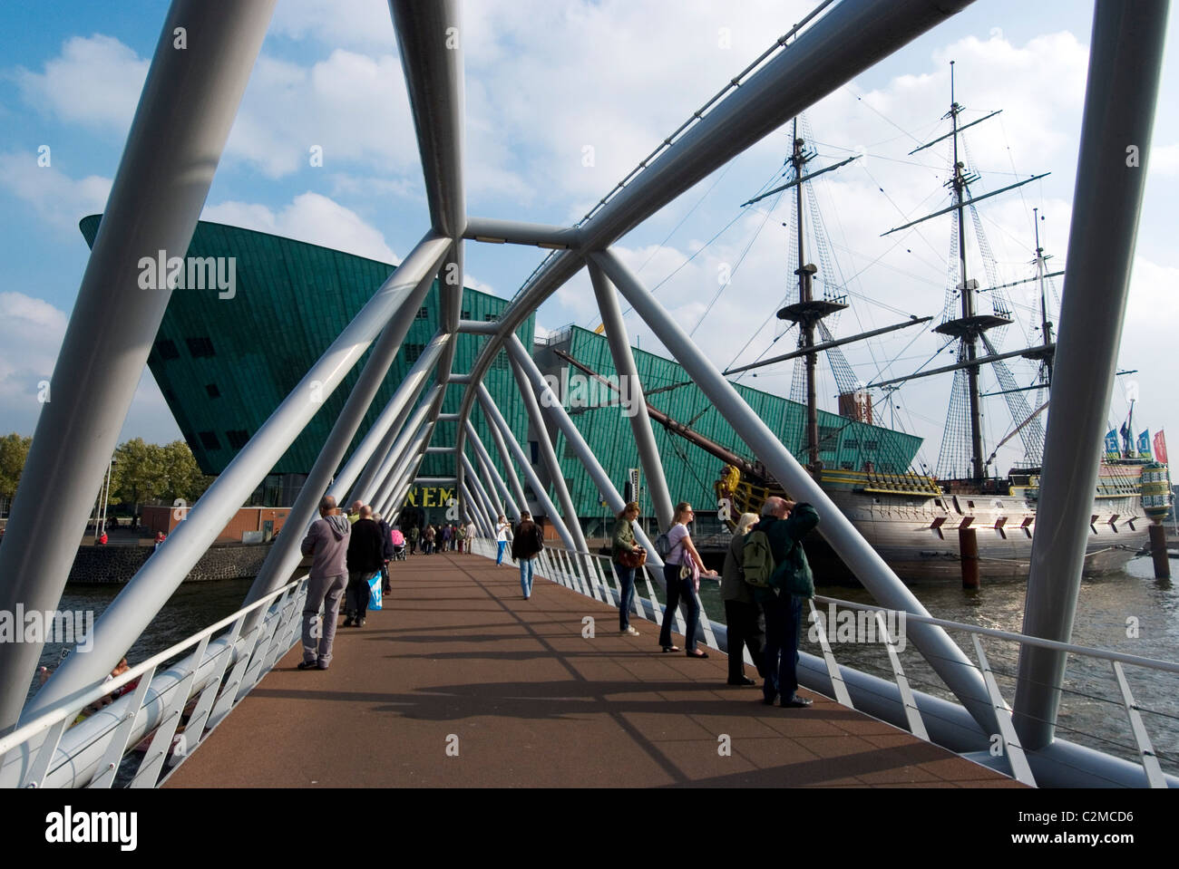 Bridge over the eastern dock to NEMO, the Netherland's largest science museum, Amsterda - Stock Image