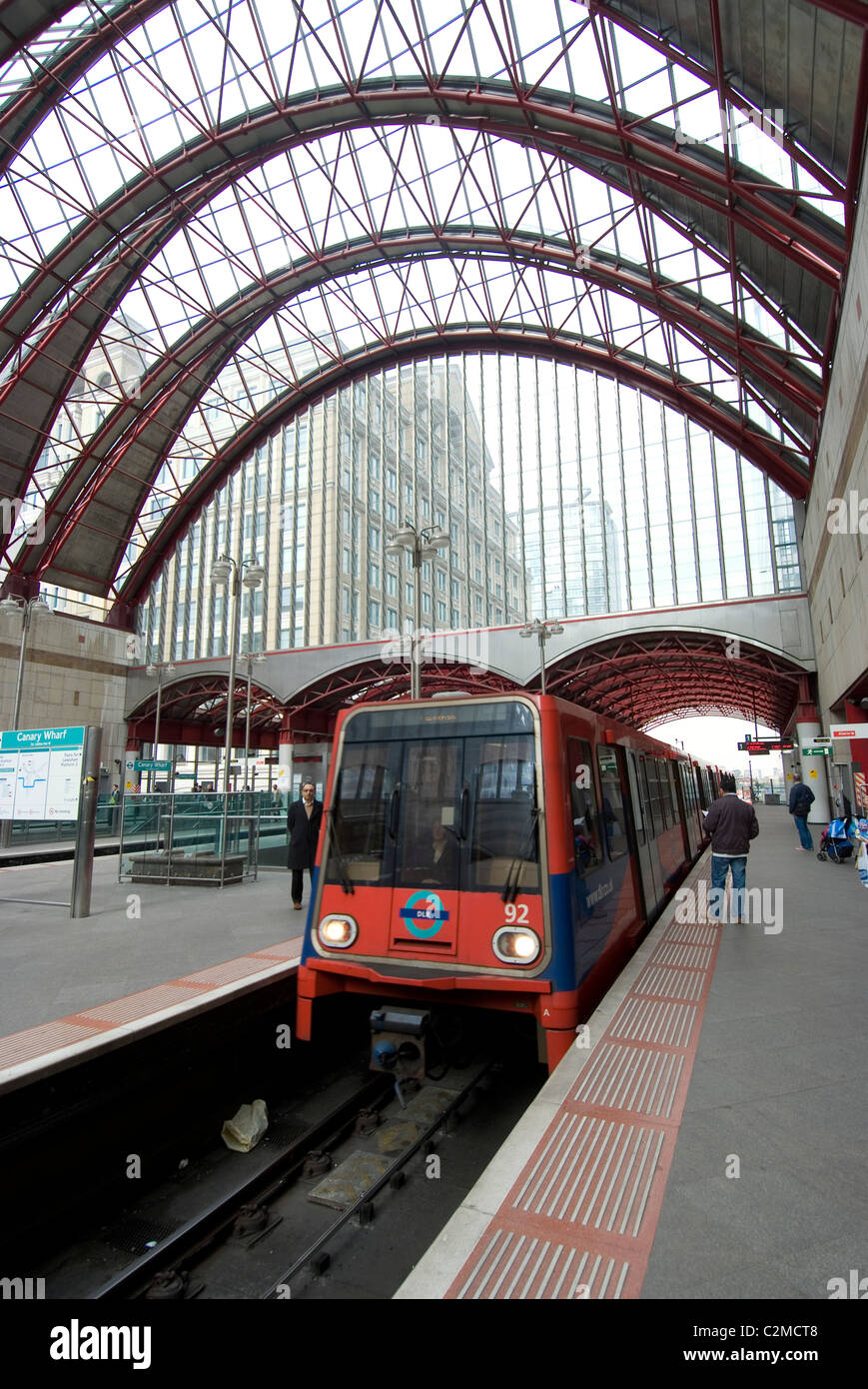 Docklands Light Railway Train at Canary Wharf station, London. - Stock Image