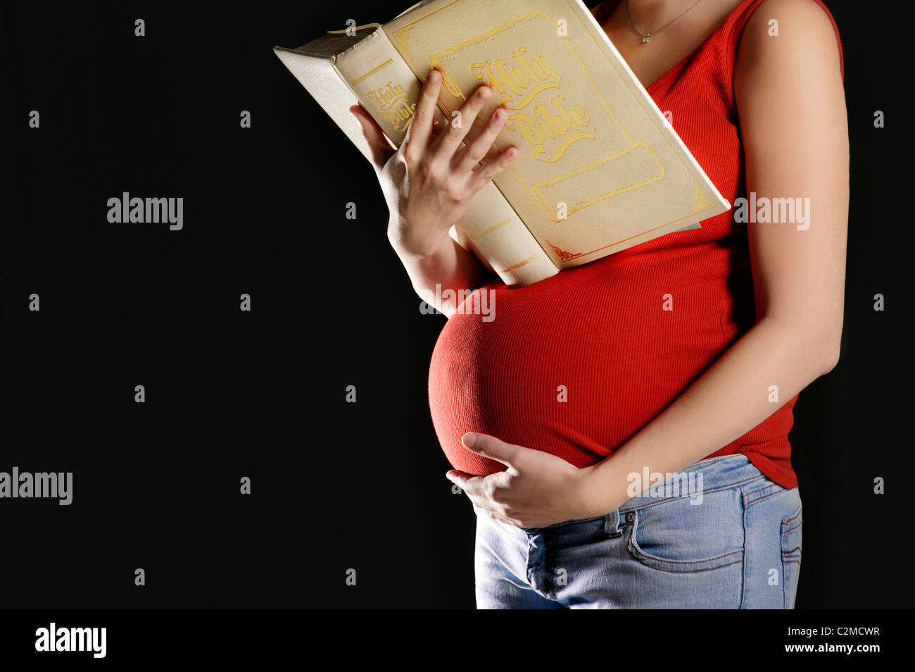 Pregnant Woman Reading A Bible - Stock Image