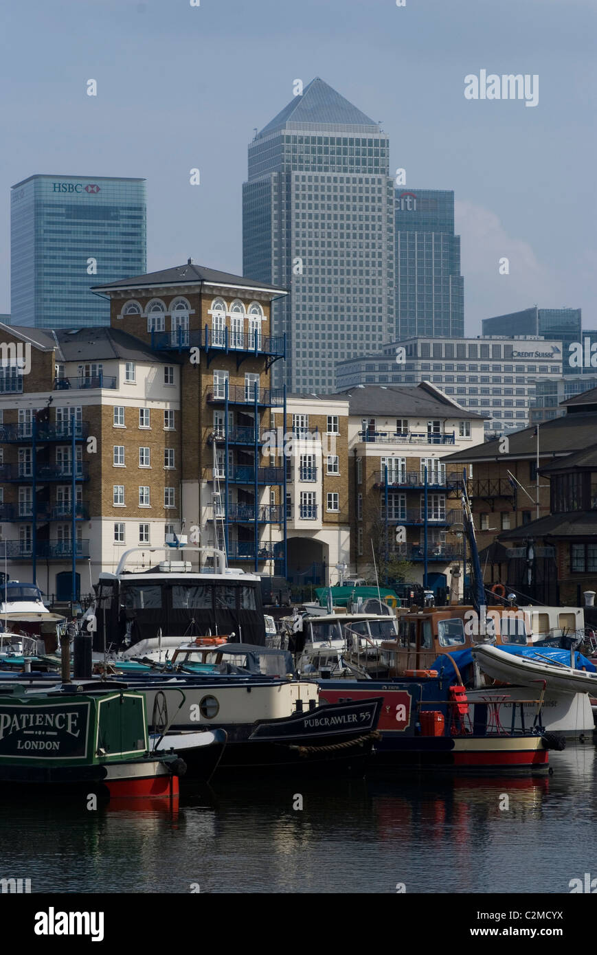 Limehouse Basin and boats with view of Canary Wharf, London. - Stock Image