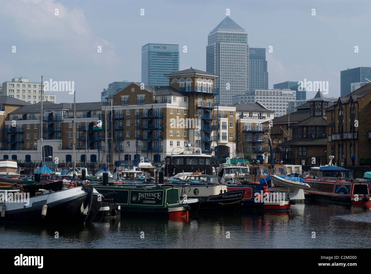 Limehouse basin and boats with view of Canary Wharf, London - Stock Image