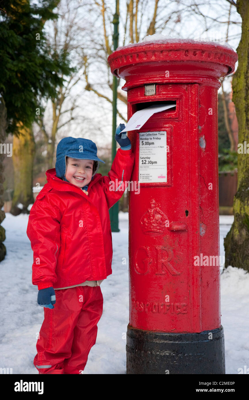 Posting a letter to Santa, England.Post box, Letter box, snow Stock Photo
