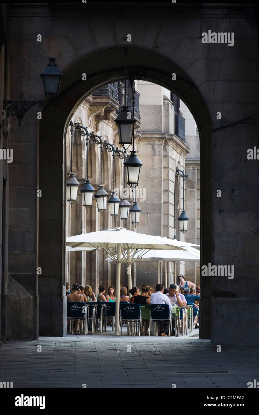 A view through an archway of one of Barcelona's cafe's. Barcelona, Spain. - Stock Image