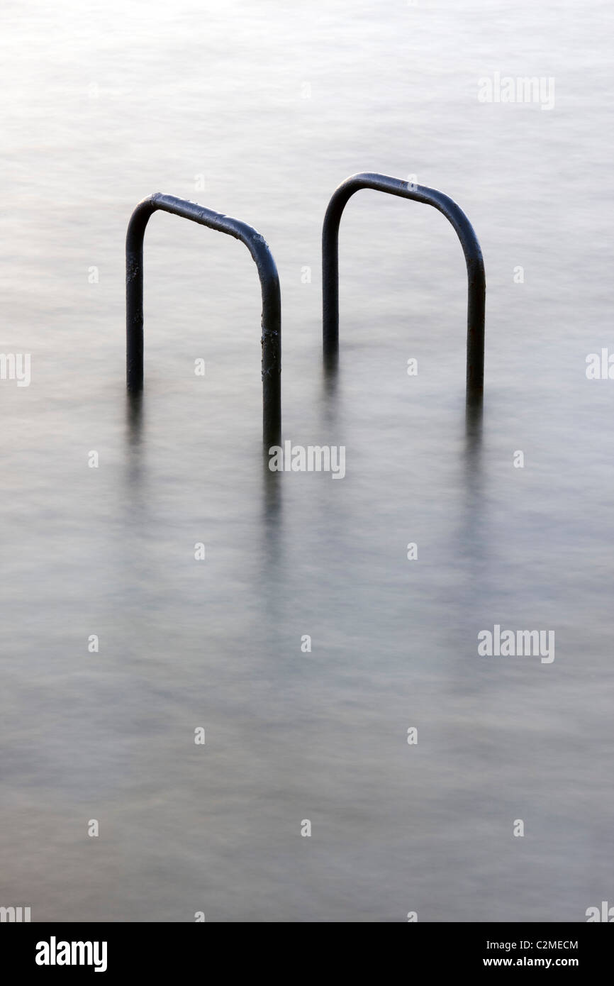 Hand rails at a tidal swimming pool in St Peters Port, Guernsey, The Channel Islands, UK Stock Photo