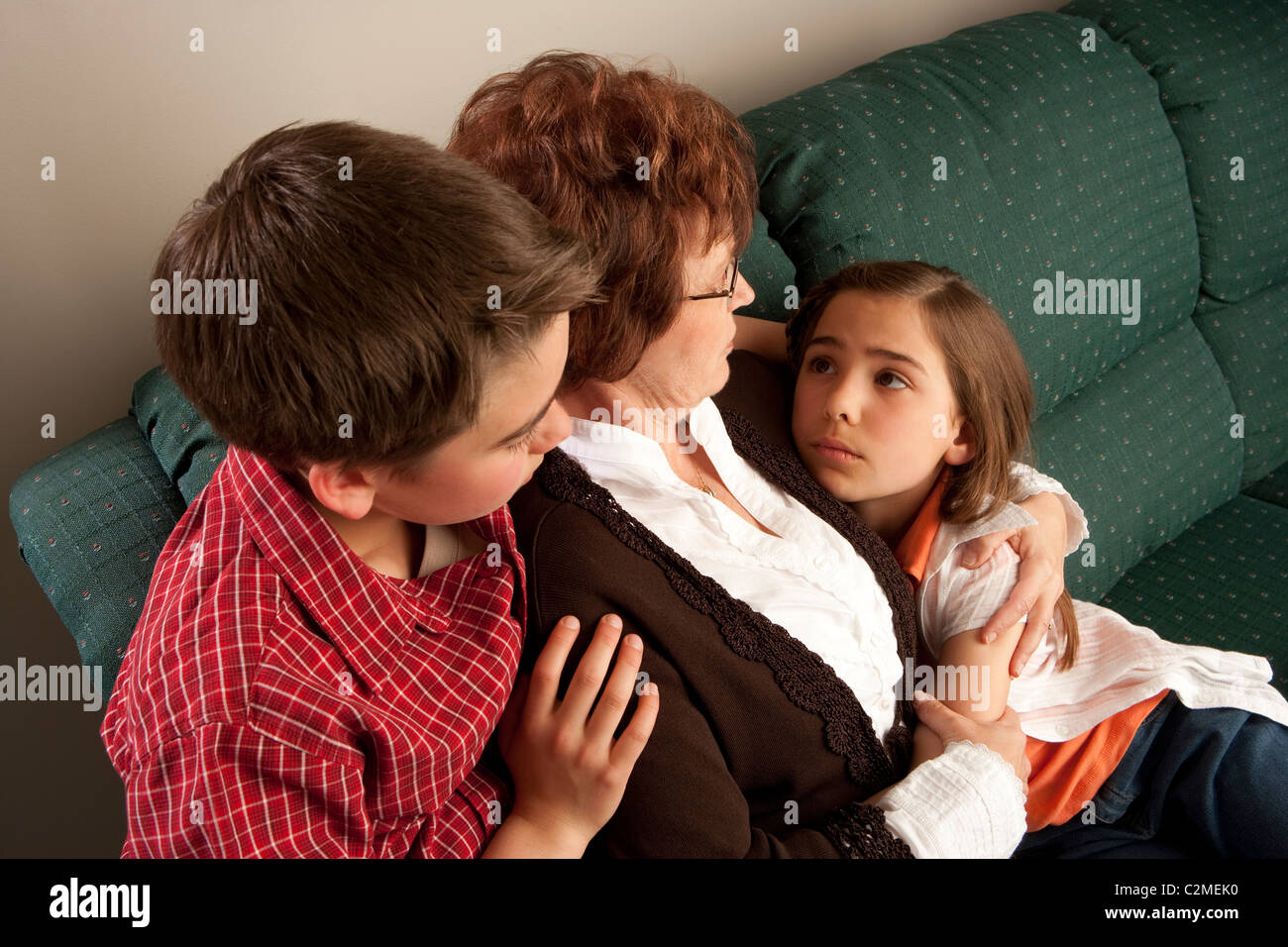 Mother And Children; Worried Family Embrace Each Other - Stock Image
