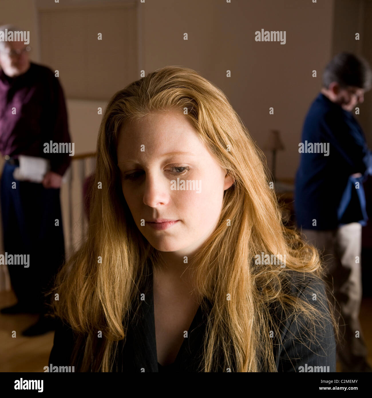Family Fight; Sad Girl With Parents Fighting In Background - Stock Image