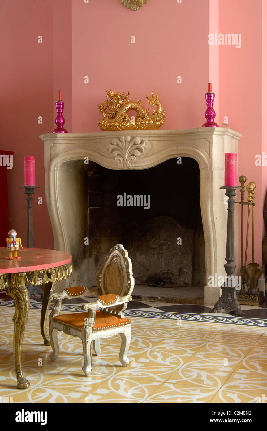 Willemijn, Haarlem. Marble fireplace surround and pink painted walls Stock Photo