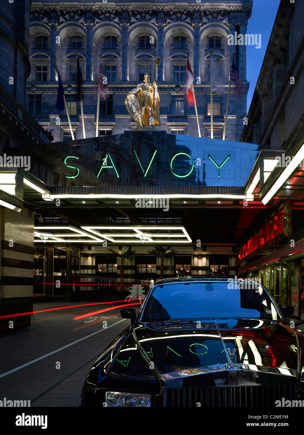 The Savoy Hotel refurbishment, completed 2010. Entrance at night. - Stock Image