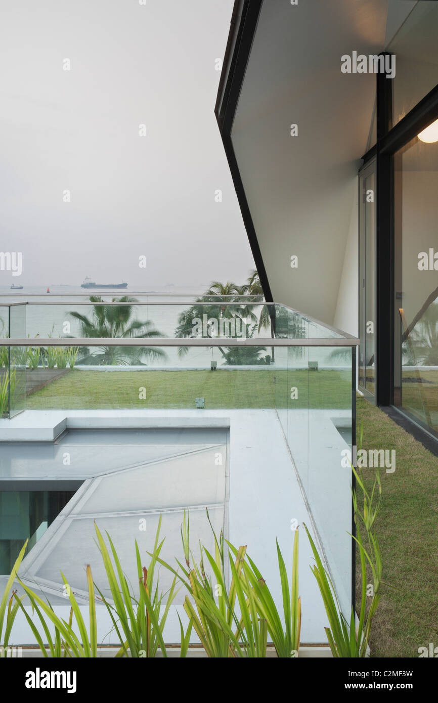 Grass floor balcony and roof with glass balustrades in dull light - Stock Image