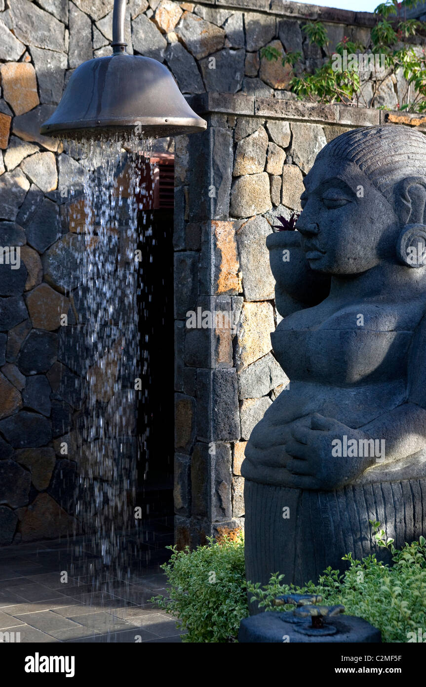 Oversized outdoor shower with female sculptural figure - Stock Image