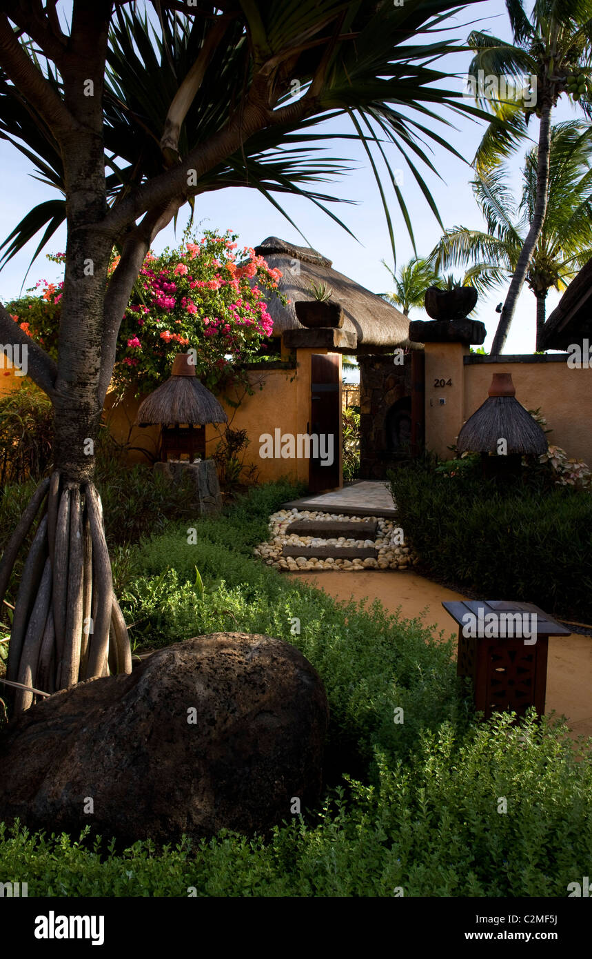 Sub-tropical planting and entrance to a villa - Stock Image