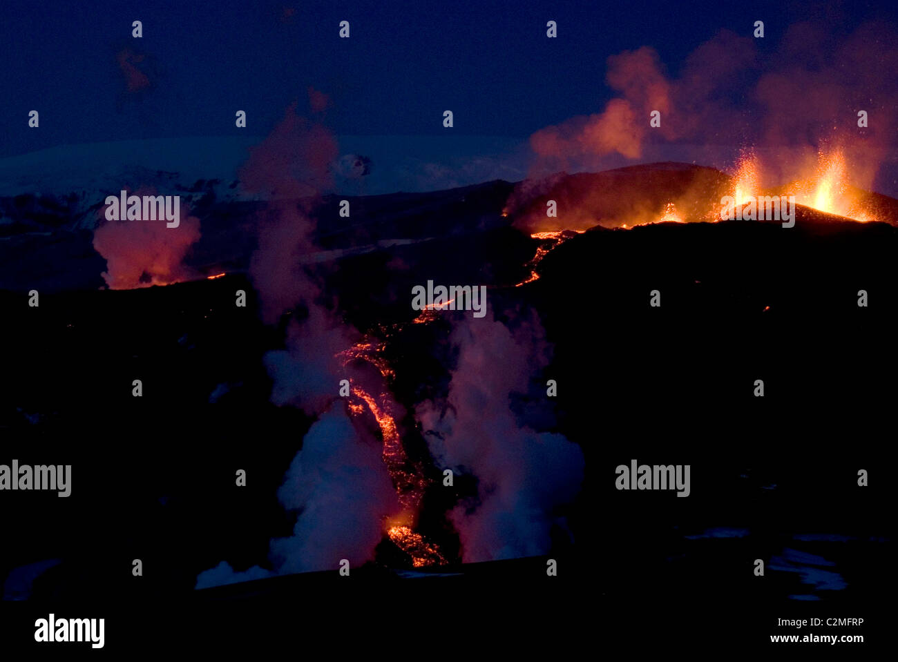 Fountaining lava and flow down mountain from Eyjafjallajokull, Southern Iceland - Stock Image
