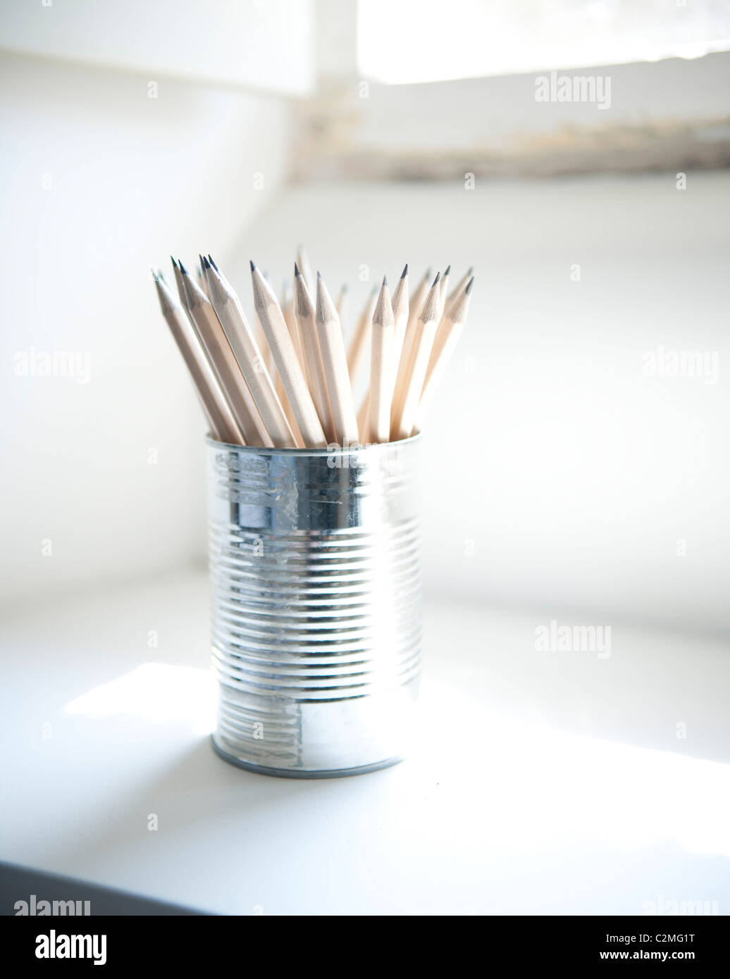 Steel can pencil holder on windowsill, Orchard Cottage. - Stock Image