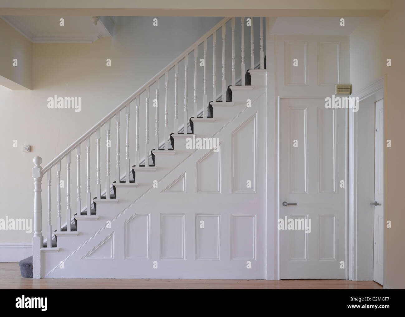 Beau White Painted Panelled Door And Staircase   Stock Image