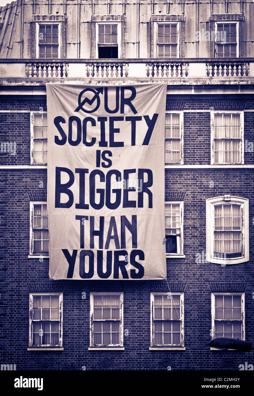 Protest banner on building in Charles Street on 26th March 2011 - the day of the TUC March through Central London - Stock Image