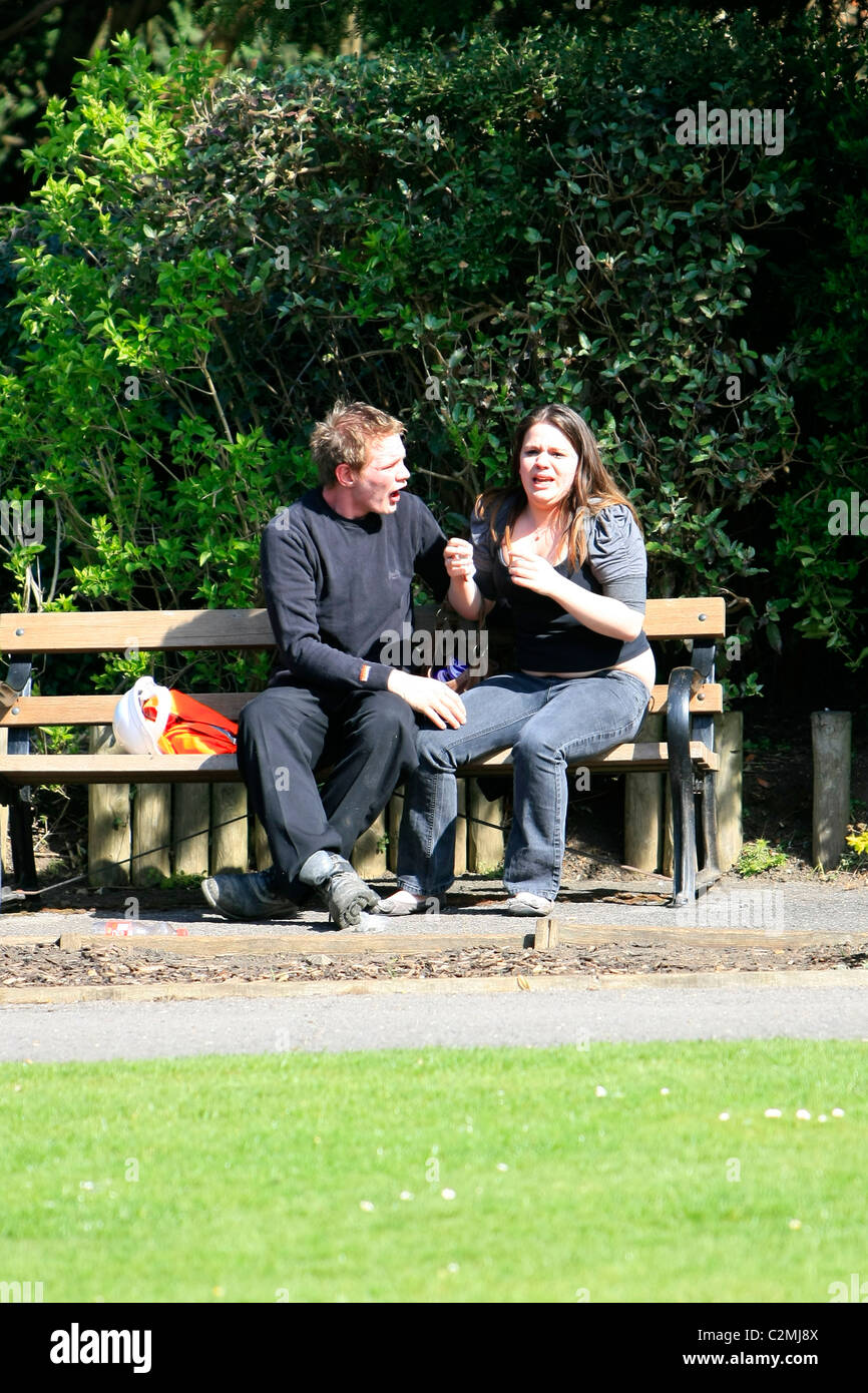 Young couple having a public argument with both people screaming verbal abuse at each other Stock Photo