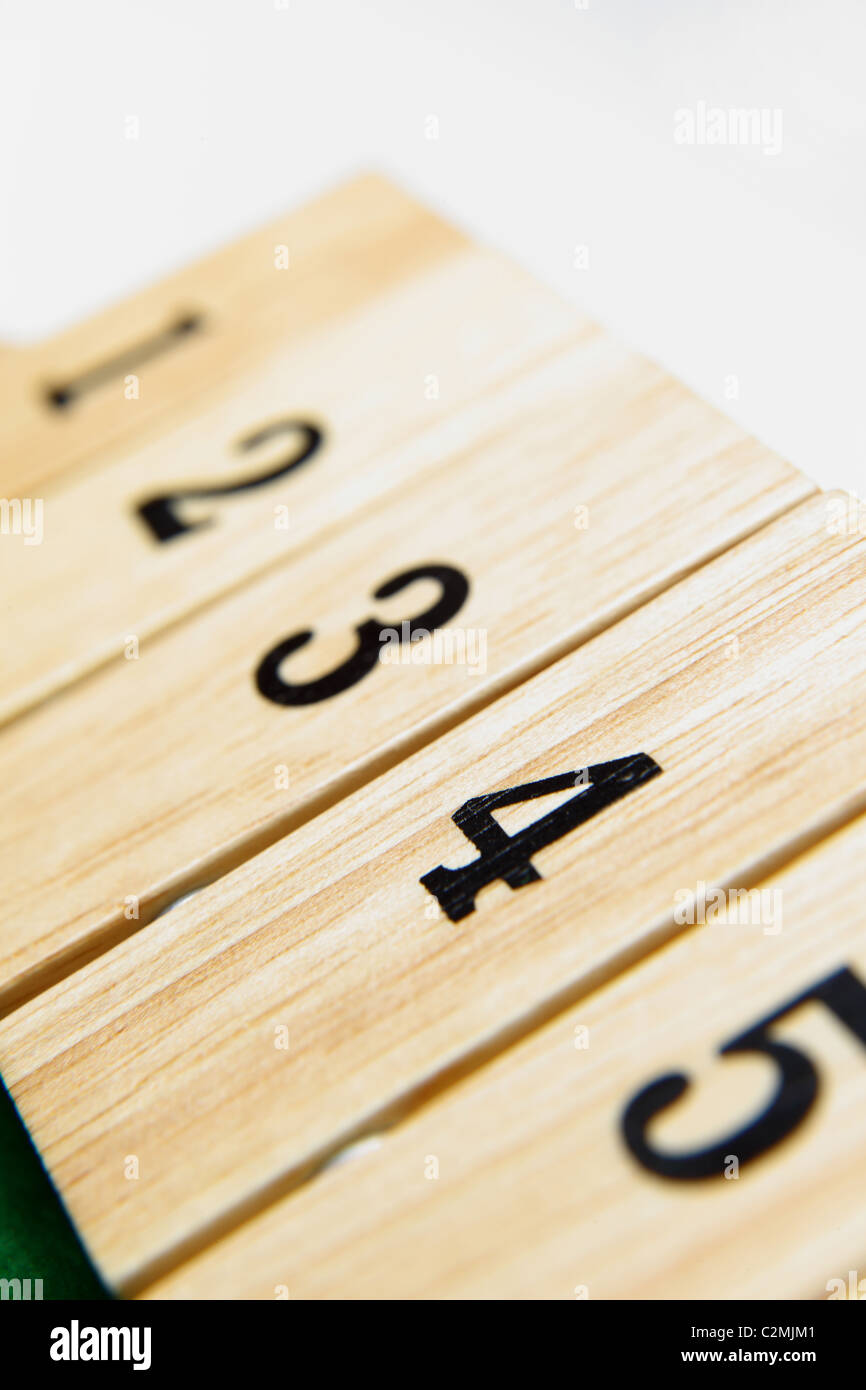 Numbers 1-5 on a wooden board game - Stock Image