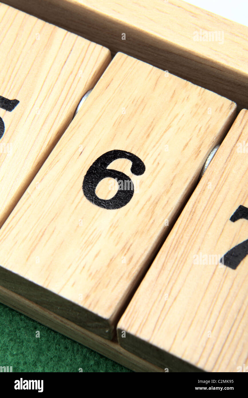 Number 6 on a wooden board game - Stock Image