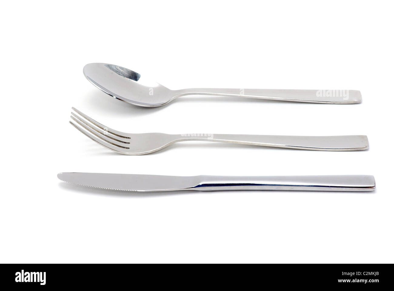 Fork, spoon and knife isolated on white background - Stock Image