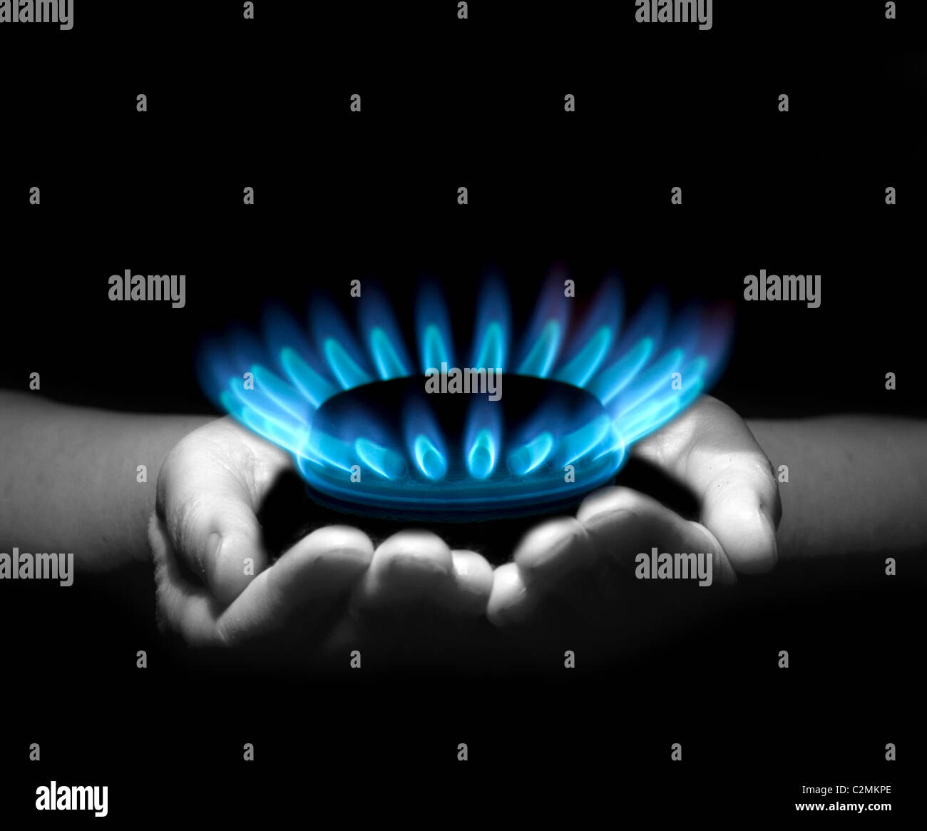 Hands holding a flame gas - Stock Image