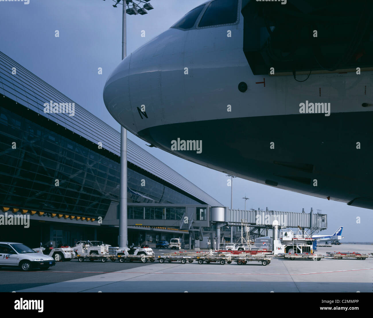 Kansai Airport, Osaka. Exterior with airplane in foreground. - Stock Image