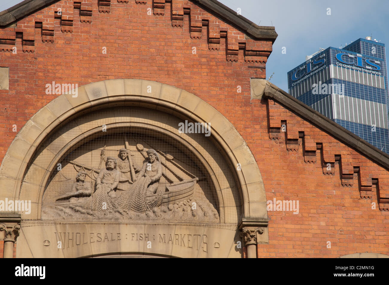 Facade of the former Wholesale Fish Market ,Northern Quarter Manchester.In contrast with the solar panel clad CIS - Stock Image