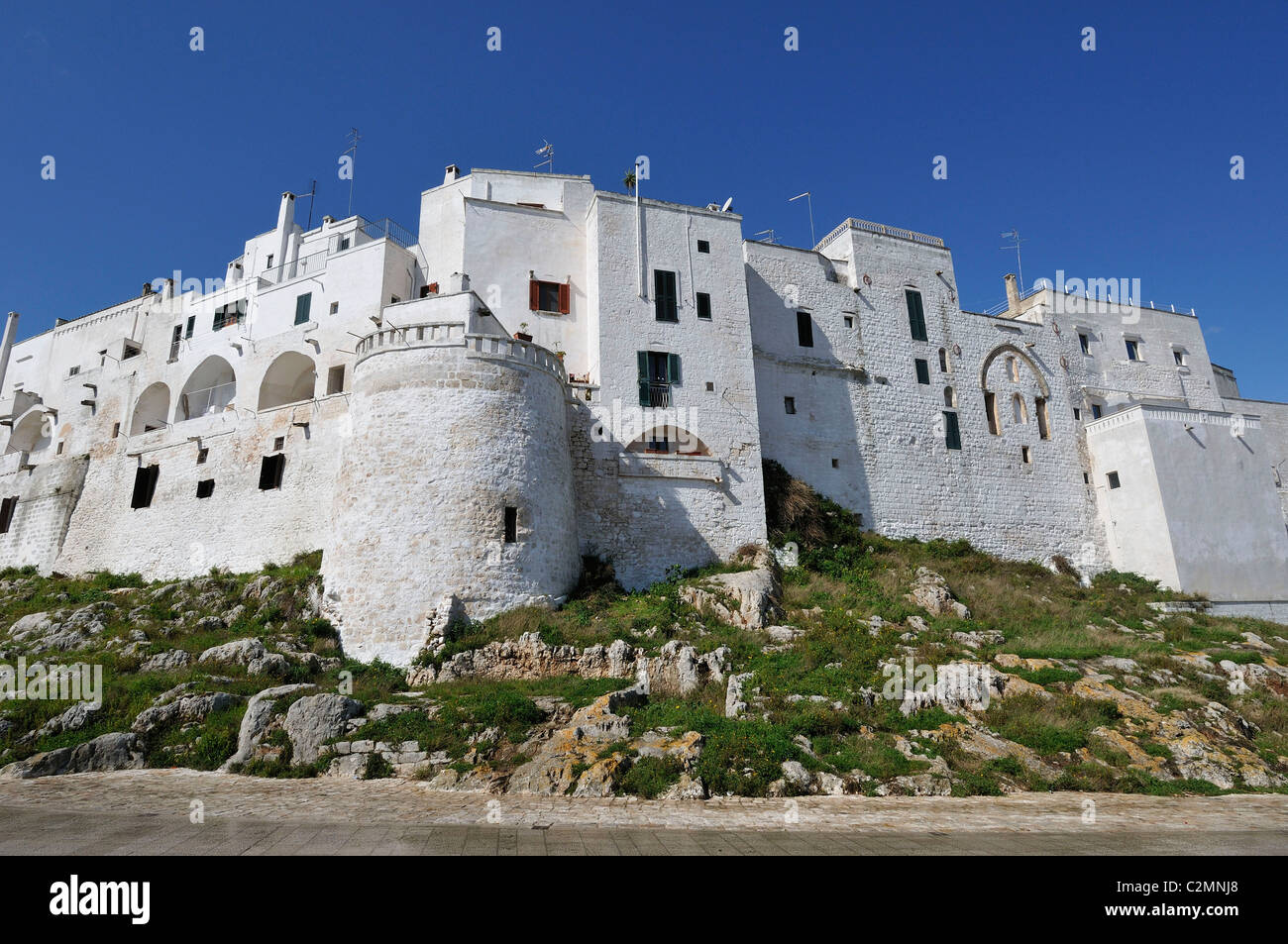 Ostuni. Puglia. Italy. Whitewashed houses and town walls. - Stock Image