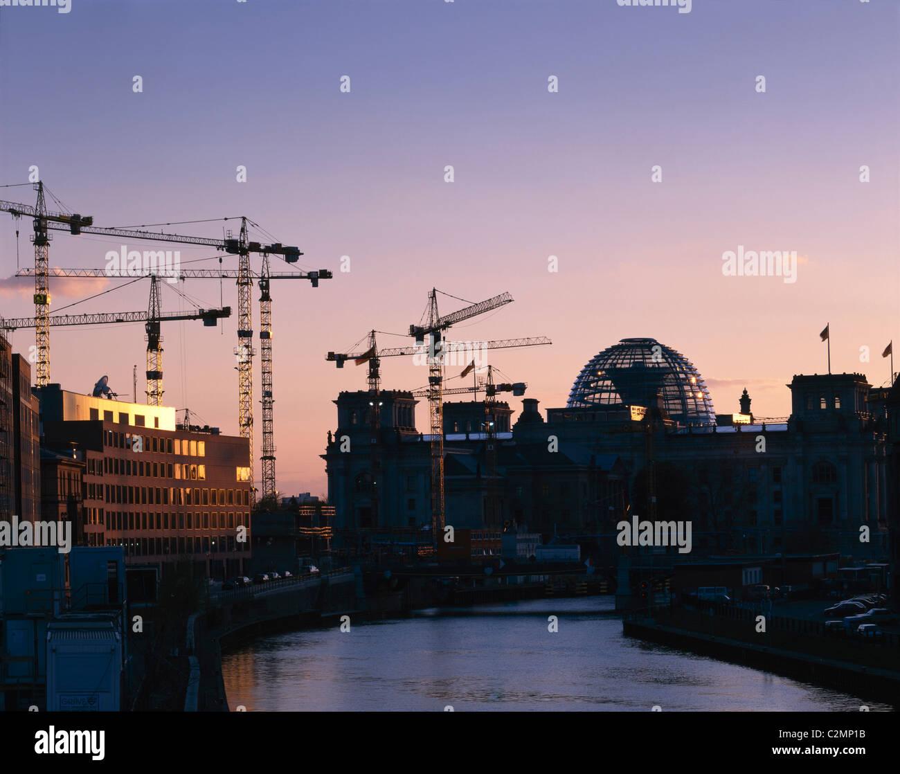 Reichstag, Platz der Republik, Berlin, Germany - Exterior with cranes - Stock Image