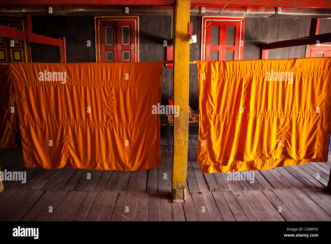 Dry on laundry string Buddhist monk's robe in Wat Si Rong Mueang, Lampang, Thailand - Stock Image