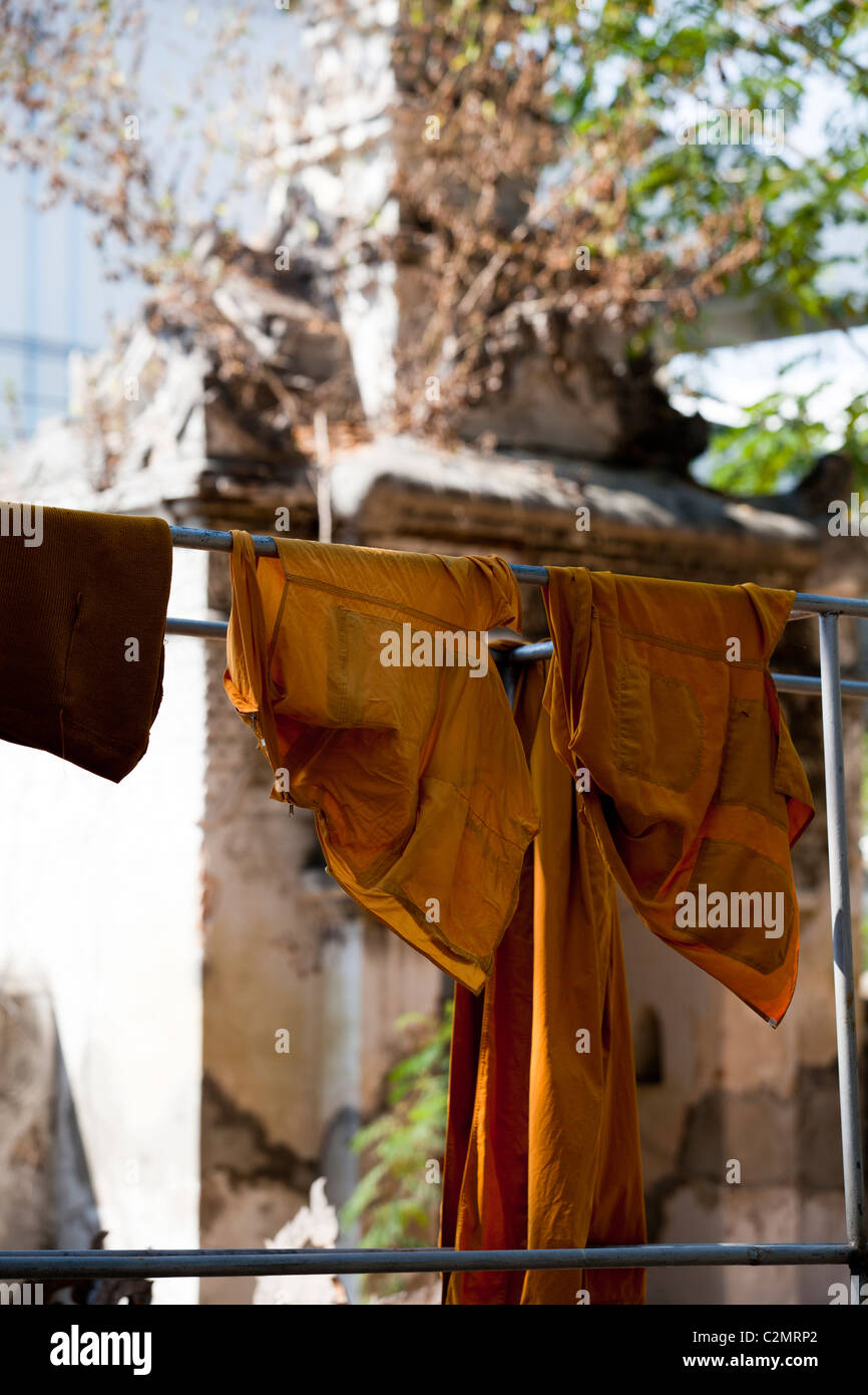Buddhist monk's robe hanging on the clothesline in Wat Sri Chum, Lampang Thailand. - Stock Image