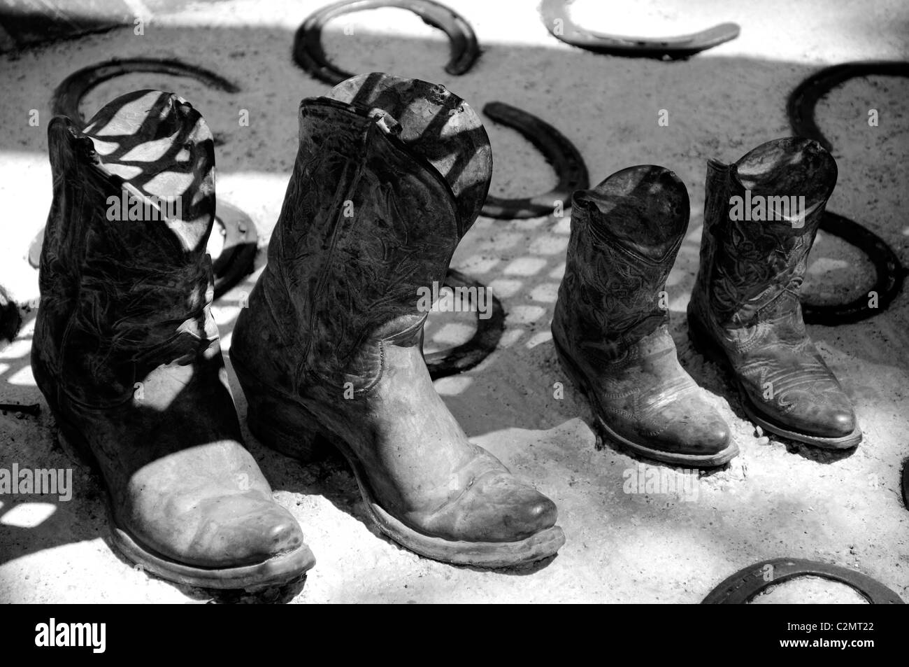 Cowboy boots and horseshoe art - Stock Image