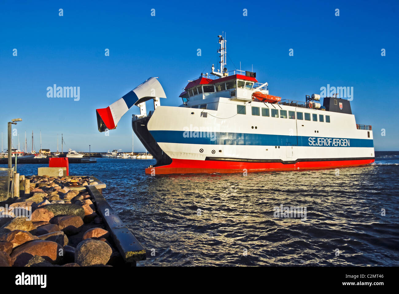 The Sejeroefaergen connecting Sejeroe with Havnsoe in Sealand is arriving at Havnsoe harbour on Sealand Denmark - Stock Image