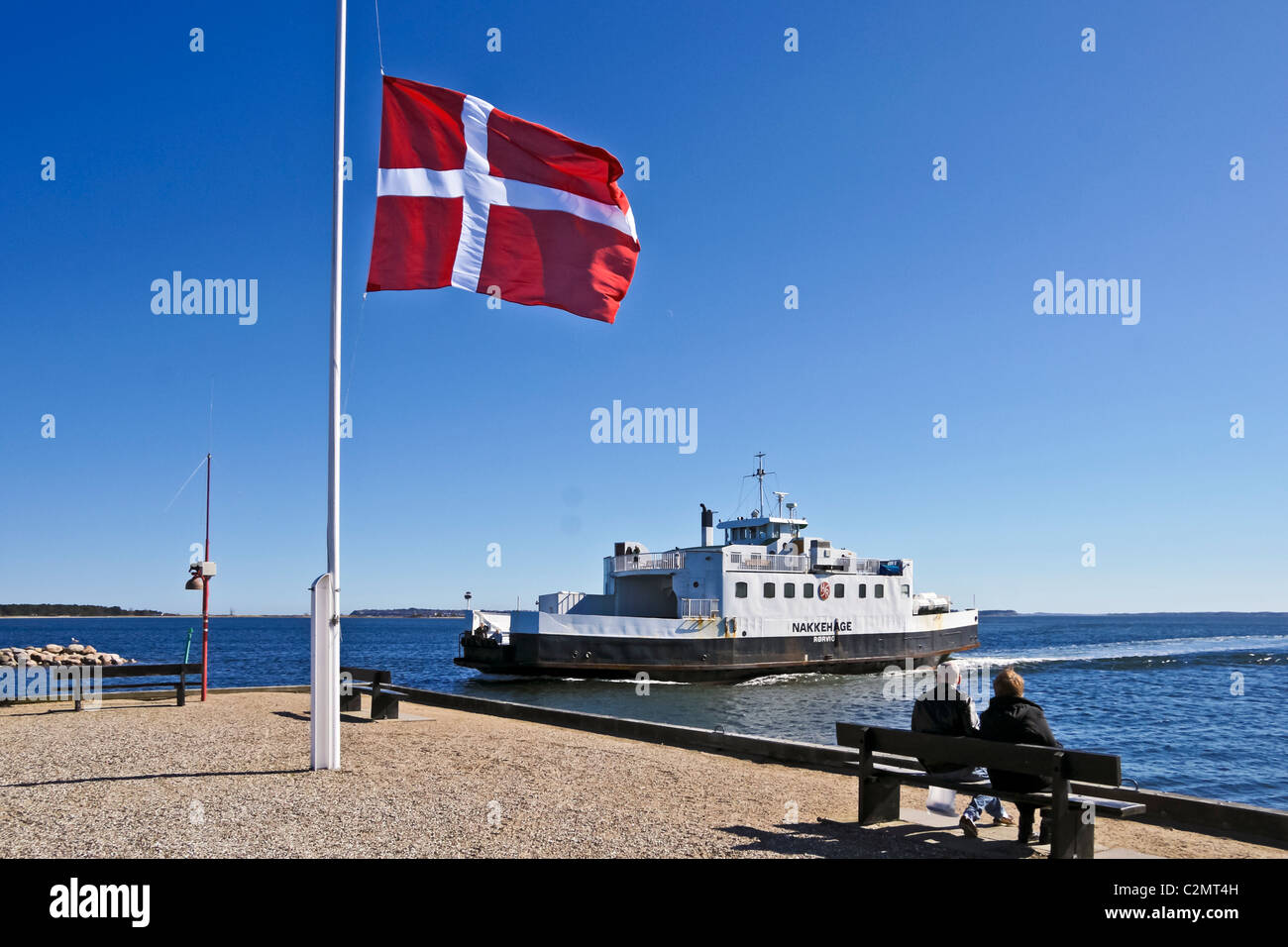 The Roervig-Hundested ferry Nakkehage arriving at Roervig on the anniversary day of Denmark's invasion by Germany - Stock Image